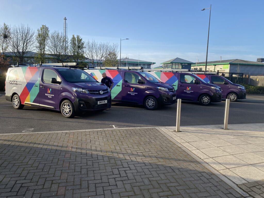 Four CCHA branded vans lined up in the CCHA car park